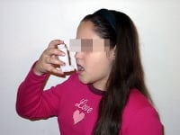 A child with asthma using a metered dose inhaler.