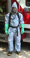 Rescuer wearing level A protection, rear view. By definition, level A protection incorporates either a self-contained breathing apparatus (SCBA, shown here) or a supplied-air respirator (SAR). The wearer is encapsulated completely. Photo credit: Tom Blackwell, MD.