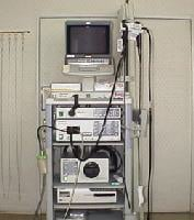 The whole system for GI endoscopy, including the fiberoptic scope with embedded camera, monitor, keyboard, video recorder, and photo printer system.