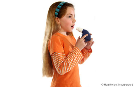 A child taking a deep breath to get ready to use the peak flow meter
