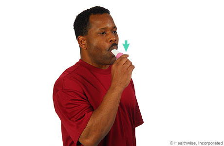 Picture of a man inhaling medicine