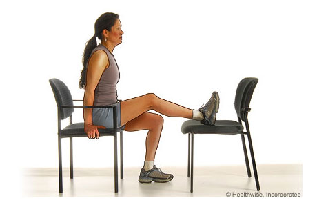 A woman doing the knee extension exercise