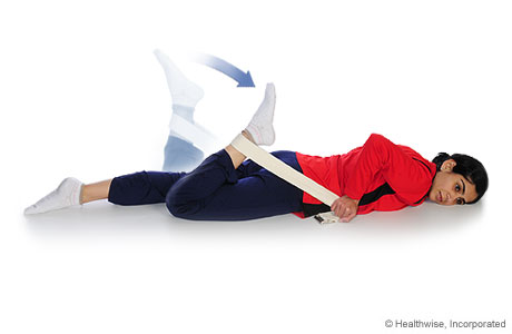 A woman doing a quadricep stretch (facedown)