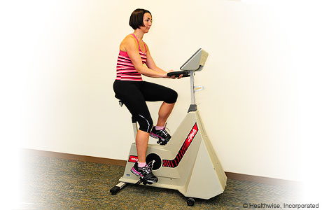 A woman exercising on a stationary bike