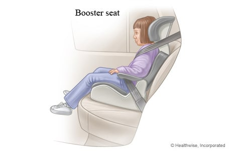 Young child in a booster seat