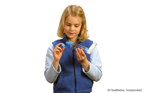 Photo of a girl removing the spacer cap