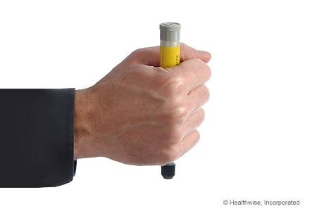Photo of holding epinephrine injector in fist