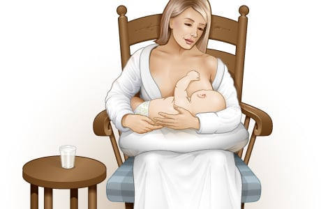 Picture of a woman cradling and breast-feeding her baby