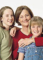 Photo of a woman with two teenage girls