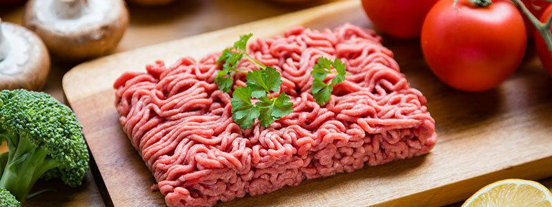 Raw ground beef on a kitchen table.