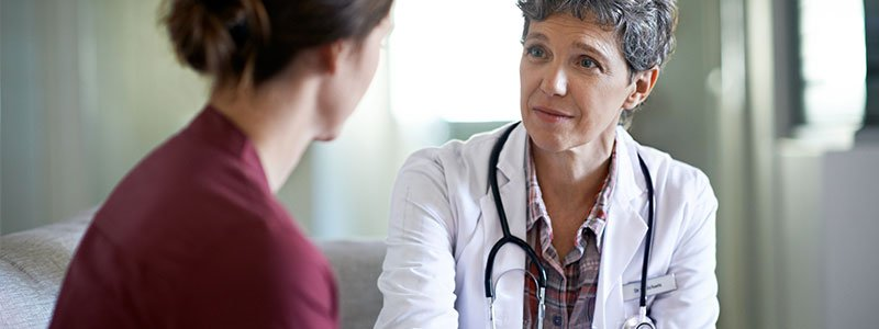 A doctor talking with her patient.