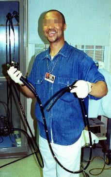 Picture of a healthcare professional holding and endoscope.