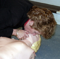 Provide two rescue breaths. Place you mouth around the victim's mouth; pinch off the nose and administer two slow breaths. Make sure the chest rises with each breath.