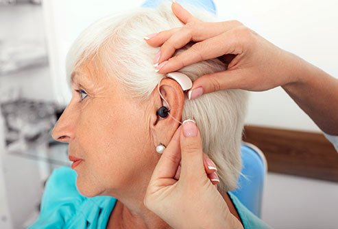 Hearing aids may be digital or analog devices that are wearable or implantable. They amplify sound and may block background noise for people with hearing loss.