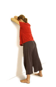 Picture of a woman leaning against a wall