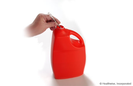Throwing away the needle in a solid plastic container