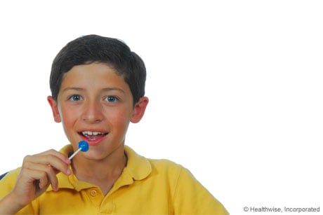 Photo of person getting quick sugar from a lollipop