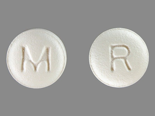round, white, imprinted with R, M