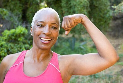 Photo of woman flexing muscles.