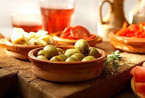 Photo of small plates of olives and cheese.
