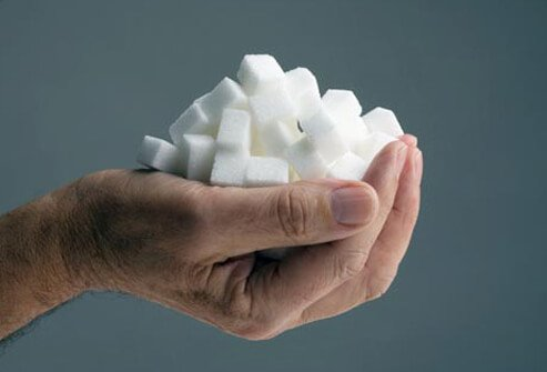 Photo of handful of sugar cubes.