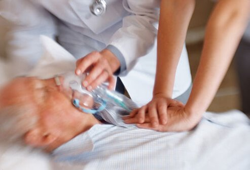 An older man receiving treatment for a heart attack.