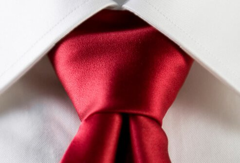 A red necktie with a white shirt.