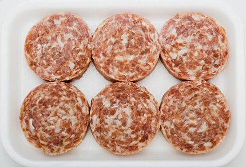 Photo of raw sausage patties.