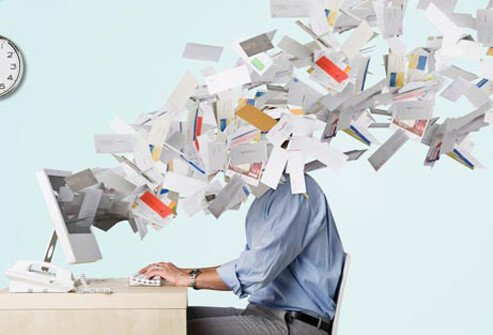 Paperwork flying over a stressed worker.