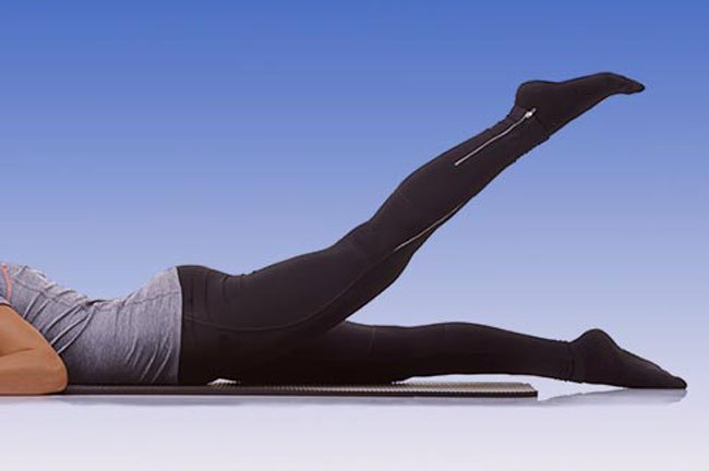 Lie on your stomach with your legs straight.