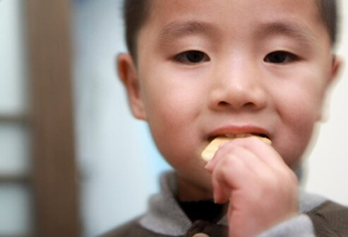 Bland foods like crackers, applesauce, bananas, and rice can help settle your child's stomach.