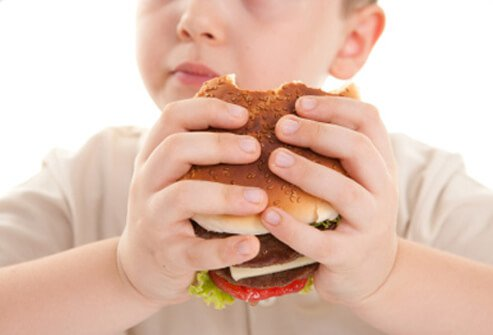 Eating undercooked meat may lead to nausea, diarrhoea, and bloating from food poisoning.