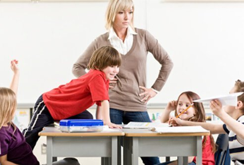A teacher is not happy about her student's inattention.