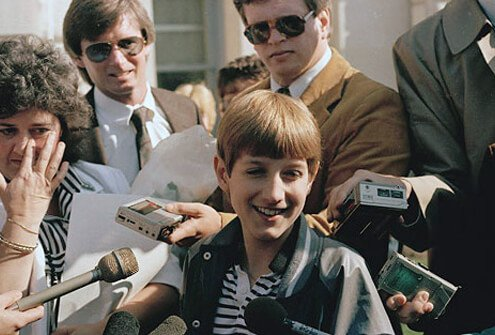 AIDS victim Ryan White surrounded by reporters.