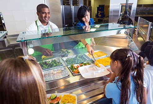 Cafeteria lunches being served to elementary students.