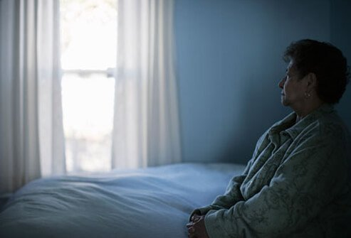 A depressed woman with a vitamin D deficiency in bed.