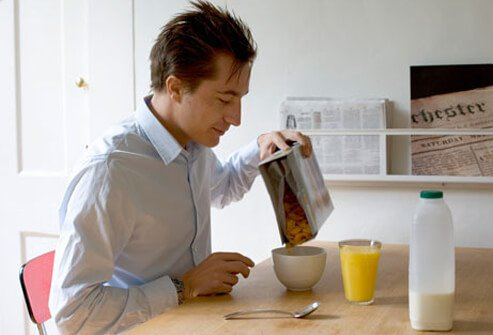 A man eating cereal, high in vitamin D, for breakfast.