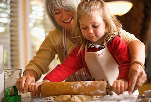 Photo of a woman baking with her granddaughter.