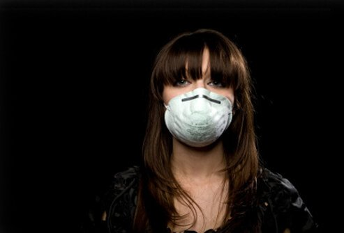 Woman wearing mask/filter to avoid catching disease.