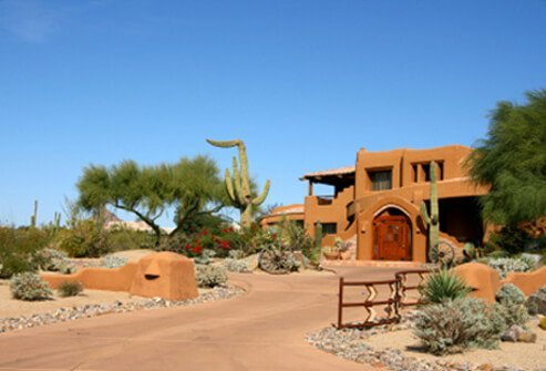 Salmon adobe style house in the Arizona desert.