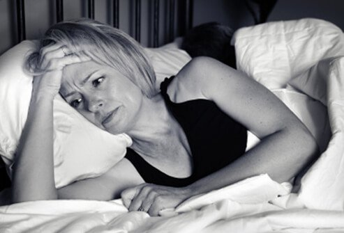 Woman with insomnia unable to sleep.