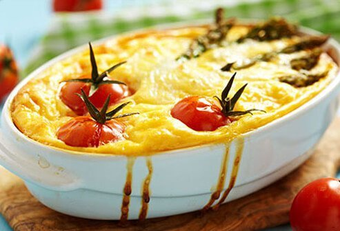 Photo of a quiche with tomato and asparagus.