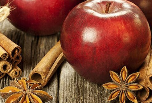 Photo of apples and cinnamon.