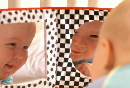 Baby Development - 12 Ways to Help Your Infant Learn & Grow slideshow S3-baby-in-playpen