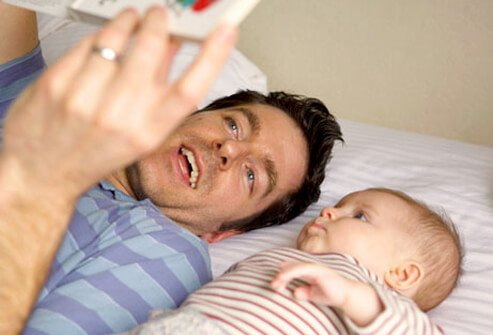 Baby Development - 12 Ways to Help Your Infant Learn & Grow slideshow S5-father-with-baby