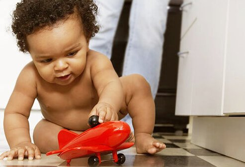 Baby Development - 12 Ways to Help Your Infant Learn & Grow slideshow S6-baby-with-plane-toy