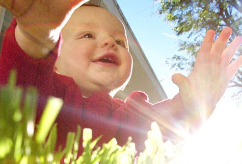 Baby Development - 12 Ways to Help Your Infant Learn & Grow slideshow S7-baby-in-grass