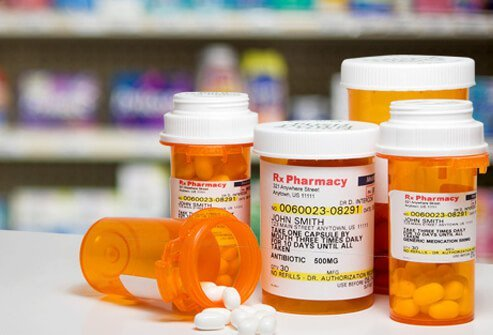 Antibiotic prescription medications in bottles.