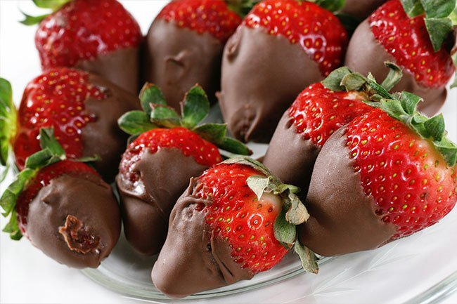 Whether they're dipped in chocolate or topped with whipped cream, strawberries are a romantic favorite.