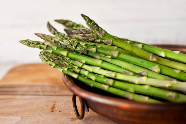 It is best to store asparagus with the ends trimmed standing in a glass of water.